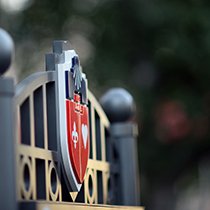 St. John's University crest on the top of the gate