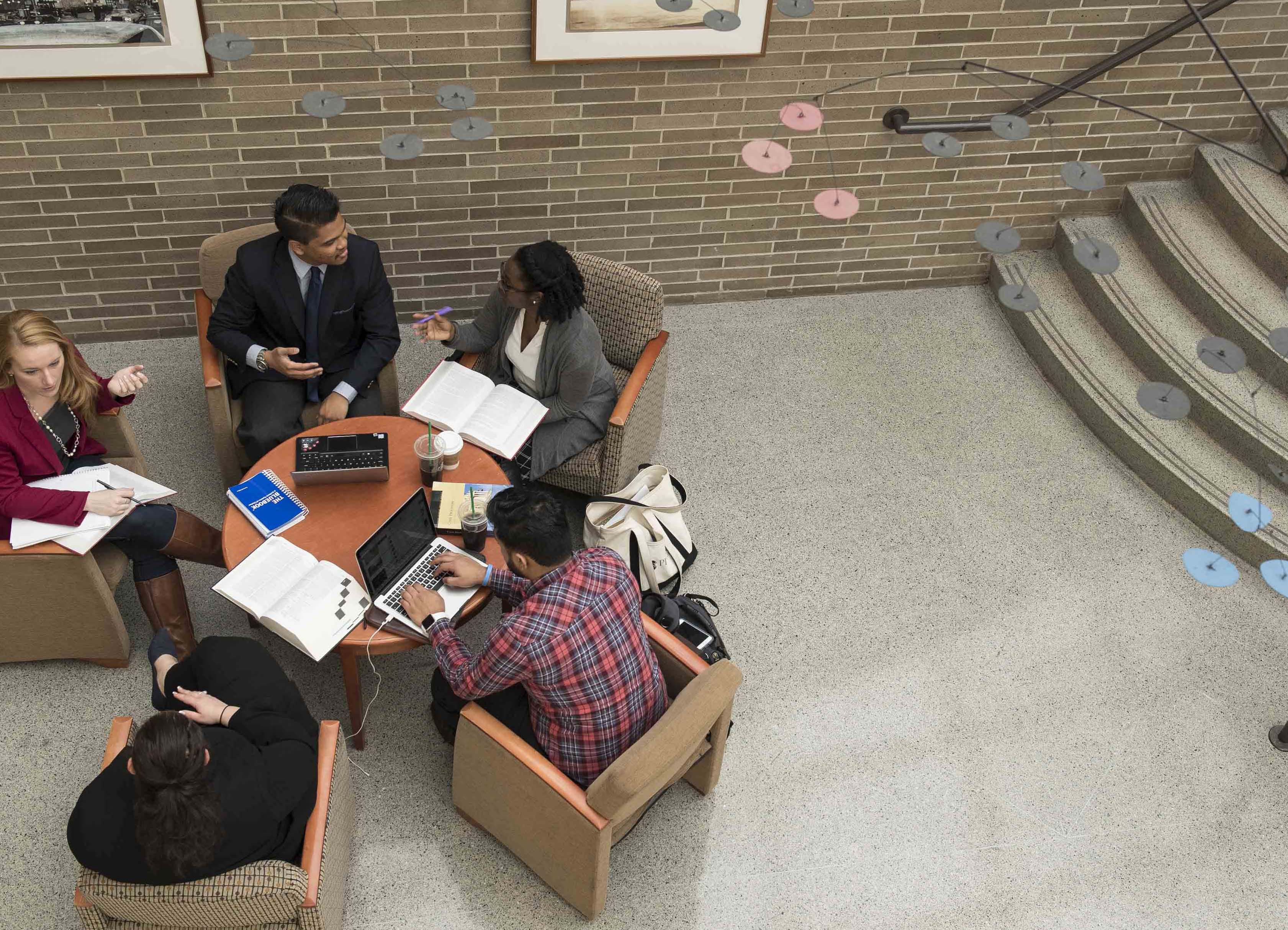 Overhead shot of students in lobby of solarium