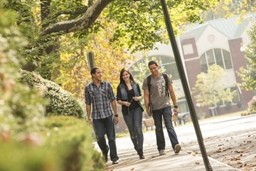 Three students walking on St. John's Staten Island campus
