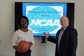 Attorney Romano and Denise Kamyuka in front of NCAA logo on screen