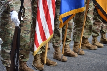 Cadets in the Red Storm Battalion Color Guard march with the U.S., Army, and battalion flags during the NYC Veterans Day Parade. St. John's cadets participate in many high-profile events like the Tunnel to Towers 5K Walk and Run, Army Ten-Miler, and NYC St. Patrick's Day Parade to name a few. (circa Fall 2019)