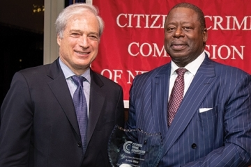 Richard Aborn, President, Citizens Crime Commission of New York City presents the Distinguished Service Award to Lewis Rice, Jr.