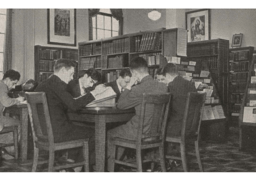 Students from 1880 sitting at table studying