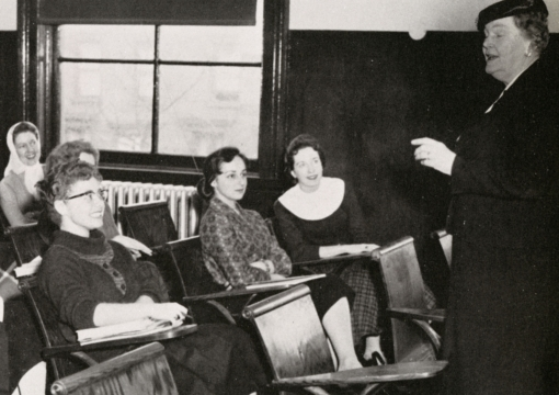 Female faculty member infront of classroom in 1958