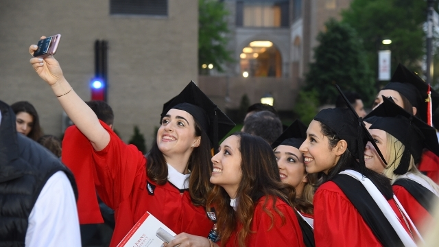 Students taking selfie at graduation 1600x900