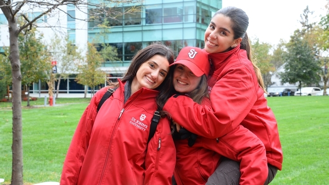 Three students posing for photo on Staten Island campus