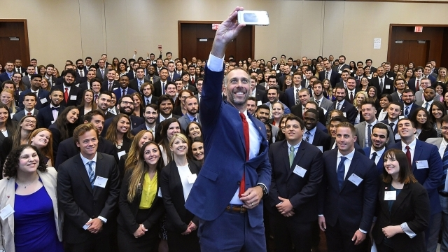 Dean Simons Taking Selfie with Incoming Class