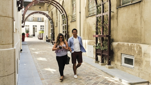 Students walking on St. John's University Paris Campus