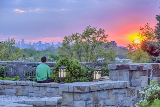 Student Overlooking NYC Skyline at St. John's