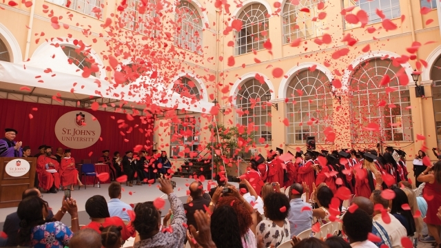 Confetti flying over the heads at Commencement ceremony