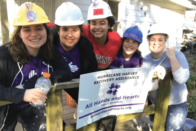 St. John's students enjoy a break while working on a home for All Hands and Hearts–Smart Response