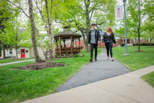 Two students walking up path on Staten Island campus