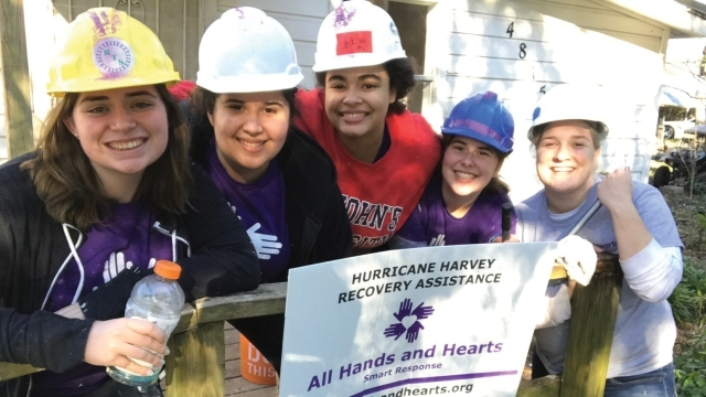 St. John's students enjoy a break while working on a home for All Hands and Hearts–Smart Response 1600x900
