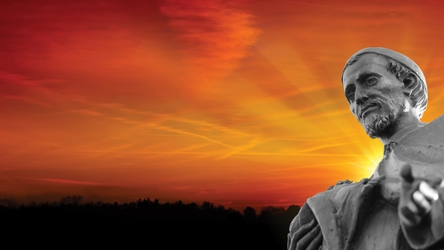 St. Vincent de Paul statue with sunset background