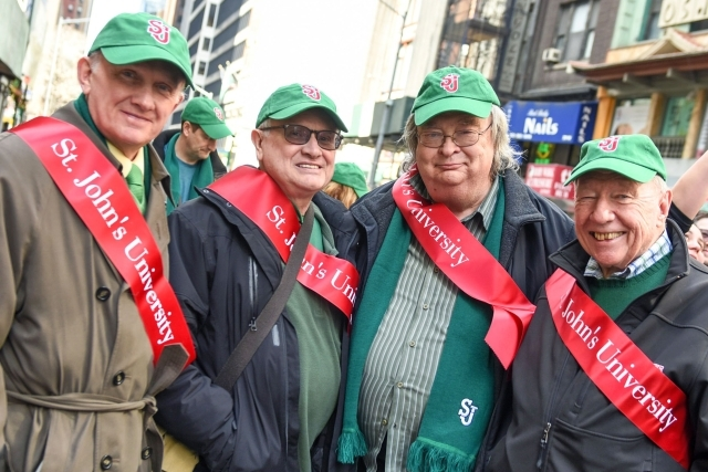John Clarke at the St. Patricks Day Parade posing with 3 other men