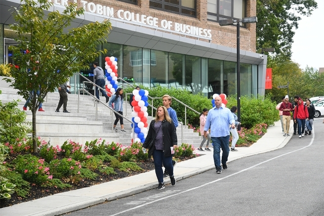 Guests walking past Tobin College entrance