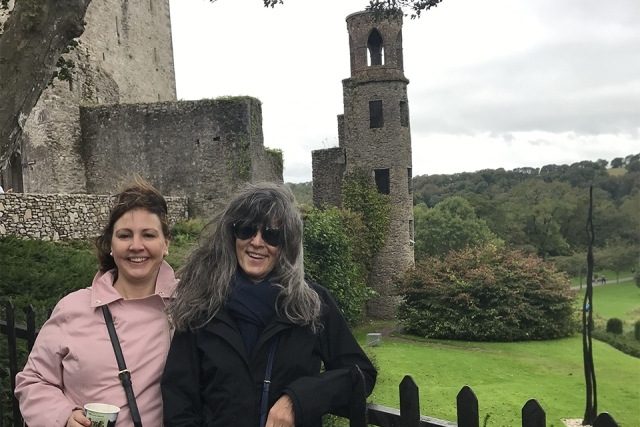 Two women in front of a castle