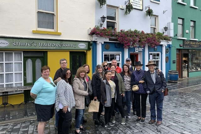 Alumni and Friends in Ireland in front of storefronts