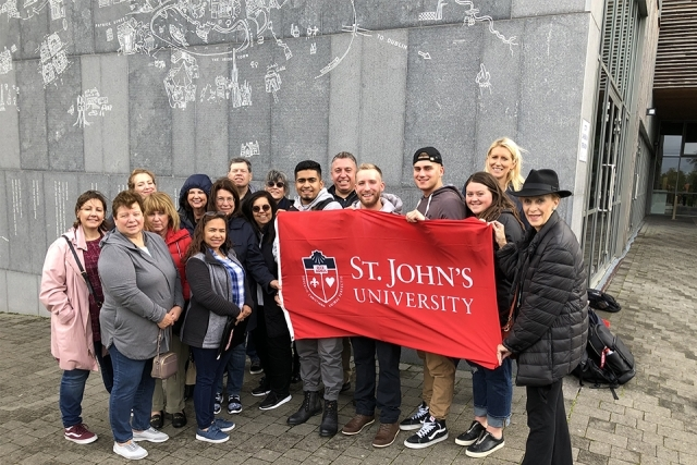 Alumni and Friends in Ireland holding a St. John's banner