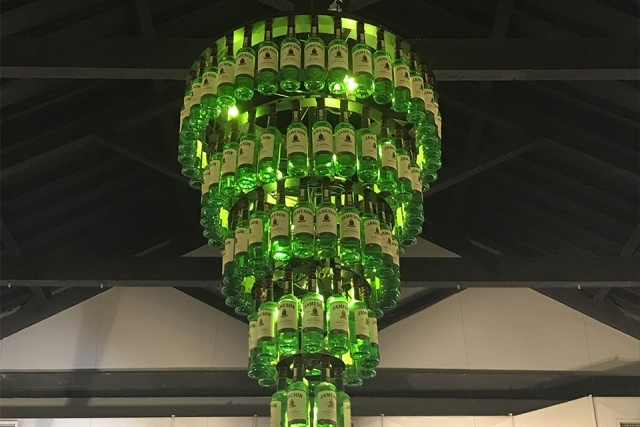 Chandelier of green glass bottles