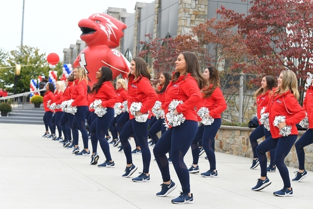 SJU cheer squad dancing