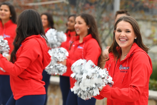 SJU cheer squad member smiling to camera