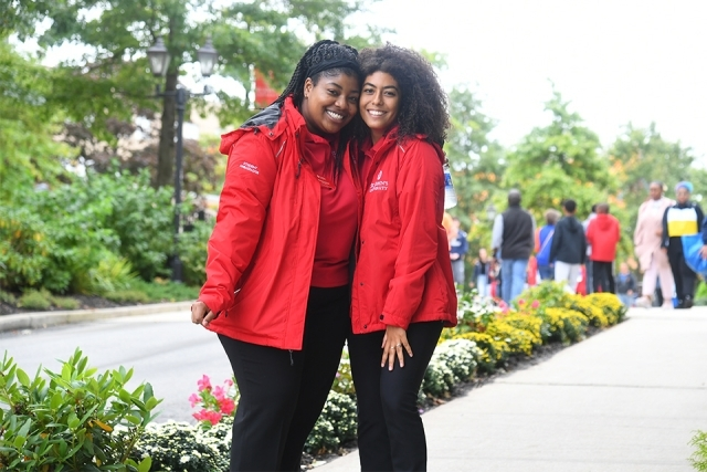 Student Ambassadors smiling in red jackets