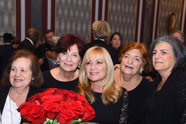 Red roses and guests at the 2019 President's Dinner