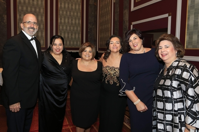 Guests pose for a photo at the 2019 President's Dinner