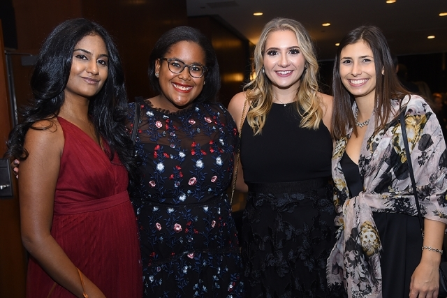 Four guest pose for a photo at the St. John's University 2019 President's Dinner