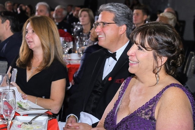Guests smiling while seated at a table