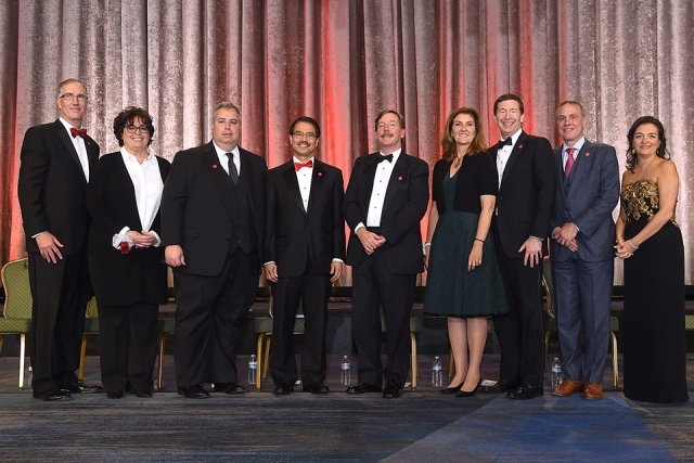 Honorees and President Gempesaw pose for a photo onstage