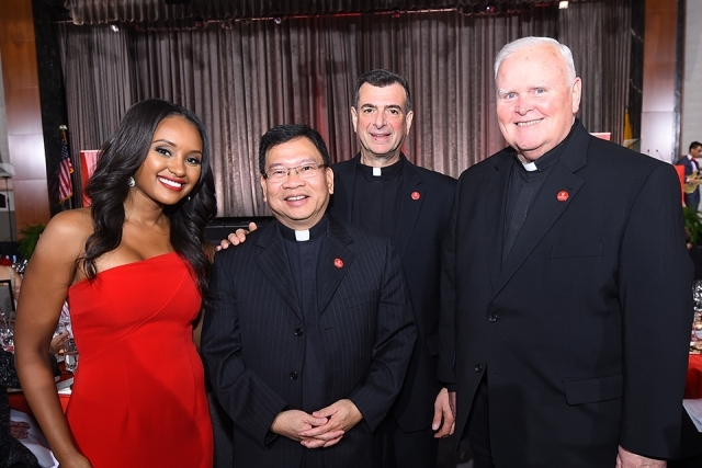 Rahel Solomon '10TCB and three campus ministry staff members at the St. John's University 2019 President's Dinner