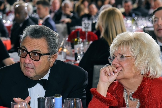 Two guests seated at the St. John's University 2019 President's Dinner