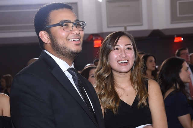 Two guests smiling and looking up at the St. John's University 2019 President's Dinner