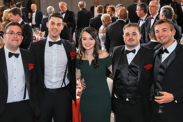 Five guests pose for a picture at the St. John's University 2019 President's Dinner