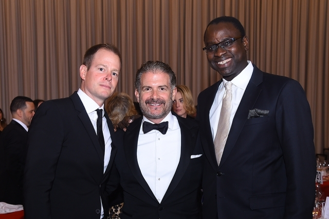 Three guests pose for a photo at the St. John's University 2019 President's Dinner