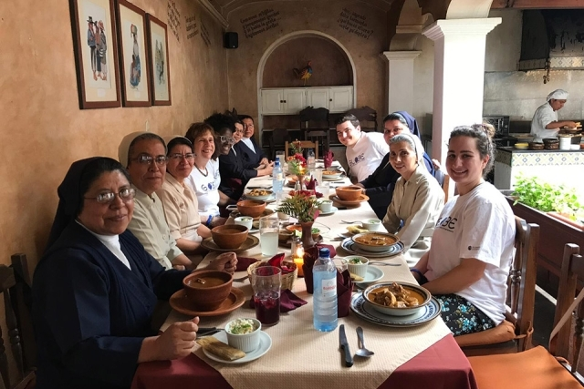 GLOBE student fellows and Daughters of Charity at dining table