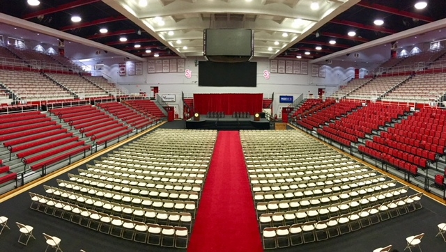 Empty carnesecca arena setup for commencement ceremony