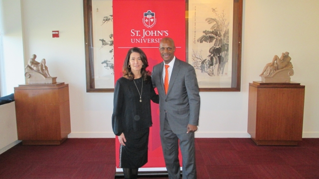 Regina Calcaterra and David Bell, Ed.D., Dean pose for a picture