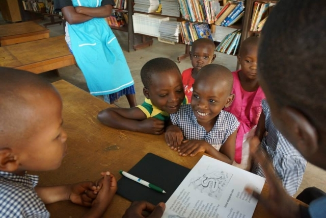 Children laughing together in Uganda
