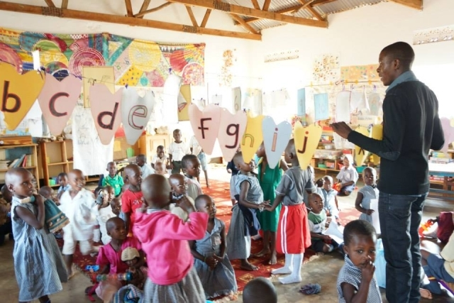 Children in Uganda learning in a classroom