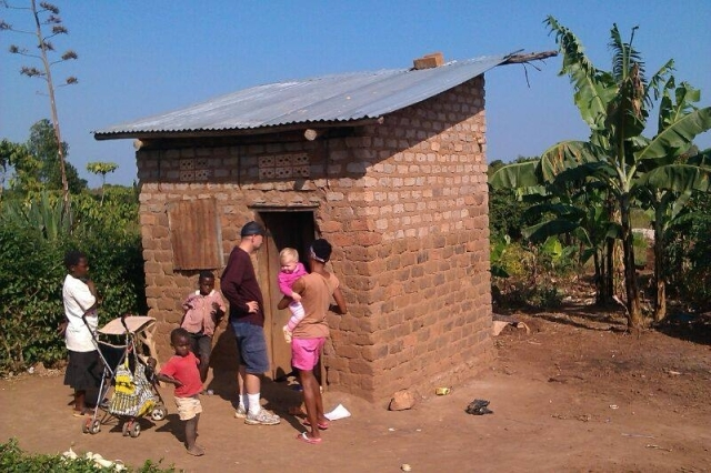 People outside a structure in Uganda