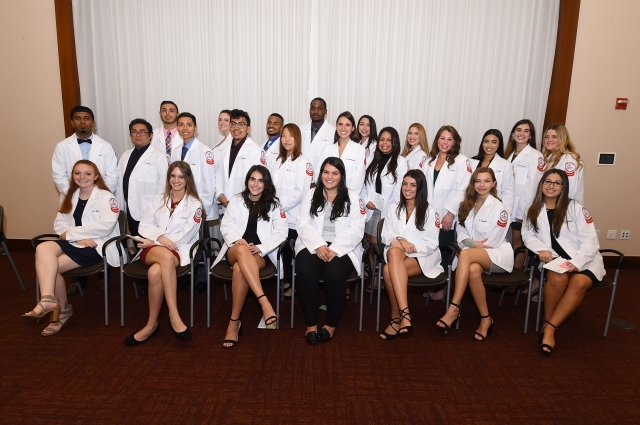 Aspiring Healthcare Professionals Don Their White Coats