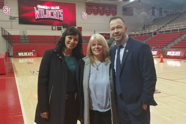 Blue Bloods Stars posing for photo with Cheryl Ohara in Carnesecca Areana