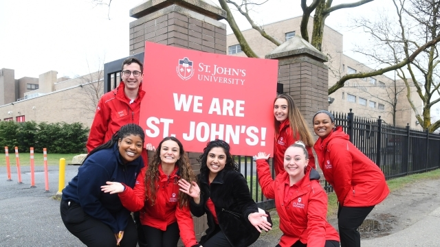 Students holding We Are St. John's Sign
