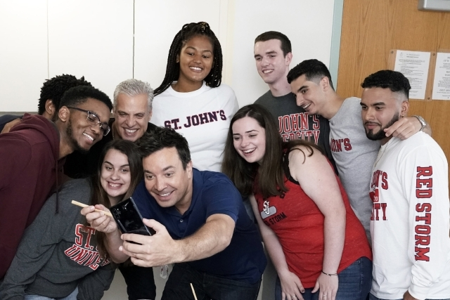 Jimmy Fallon taking a selfie with St. John's University students in dorm room