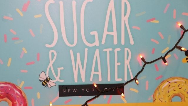 Sugar & Water NYC sign