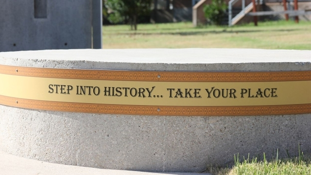 "A round piece cement with the following words wrapped around it ""Step Into History...Take Your Place"""
