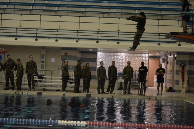A cadet takes a confident step off of the 5 meter platform while blindfolded during the Combat Water Survival Assessment (CWSA). The CWSA is used to measure individuals swimming ability. (circa Fall 2019)
